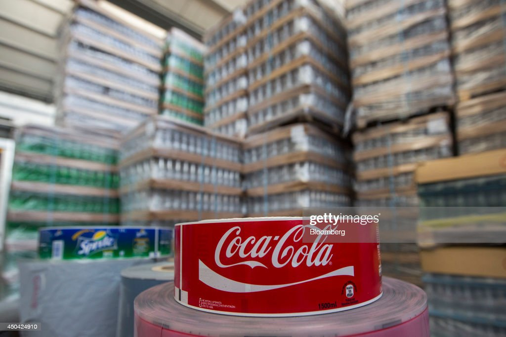 Labels for Coca-Cola and Sprite sparkling drinks sit near a store of empty bottles at the Lanitis Bros Ltd. bottling plant, part of the Coca-Cola Hellenic Group, in Nicosia, Cyprus, on Tuesday, June 10, 2014. Zug, Switzerland-based Coca-Cola Hellenic Bottling Co., which distributes Coca-Cola products in countries including Russia, wants to move away from using imported sugar for its Russian operations by 2015. Photographer: Andrew Caballero-Reynolds/Bloomberg via Getty Images