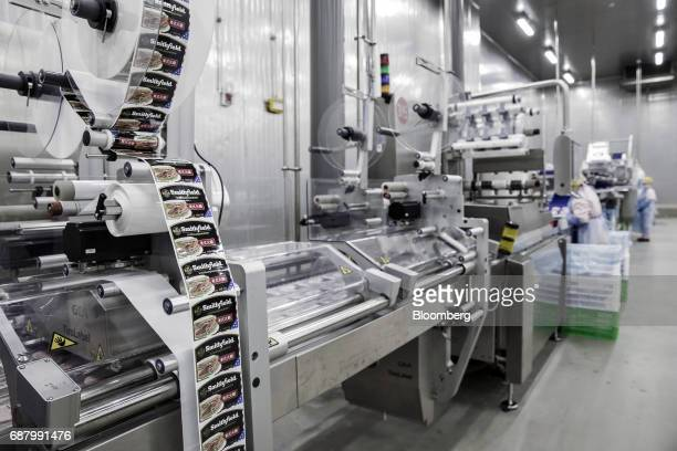 Labels for finished pork products move along a production line that processes imported Smithfield Foods Inc pork at the WH Group Ltd facility in...