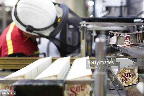 Labels for Heineken NV Sol brand beer are seen in a machine at the company's Cuauhtemoc Moctezuma production plant in Guadalajara Mexico on Wednesday...
