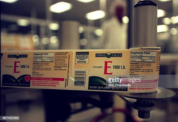 Labels for vitamin E pill bottles on automataed loading machine at Leiner Health Care Products the world s largest manufacture of vitamins and...