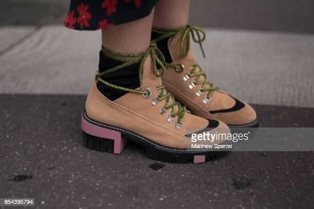 Laberiane Ponton is seen attending JOUR/N during Paris Fashion Week wearing Isabel Marant HM Zara boots on September 26 2017 in Paris France