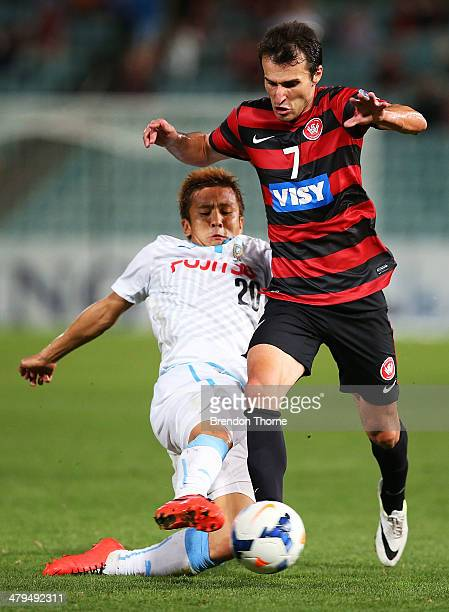 Labinot Haliti of the Wanderers competes with Junichi Inamoto of Kawasaki Frontale during the AFC Asian Champions League match between the Western...