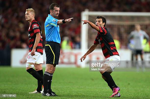 Labinot Haliti of the Wanderers disputes a decision with referee Peter Green during the ALeague 2013 Grand Final match between the Western Sydney...