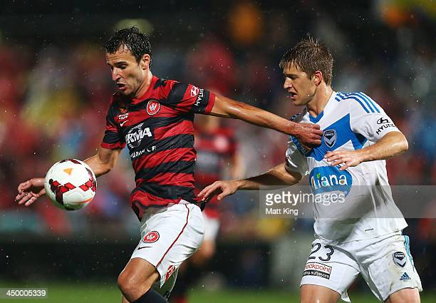 Labinot Haliti of the Wanderers is challenged by Adrian Leijer of the Victory during the round six ALeague match between the Western Sydney Wanderers...