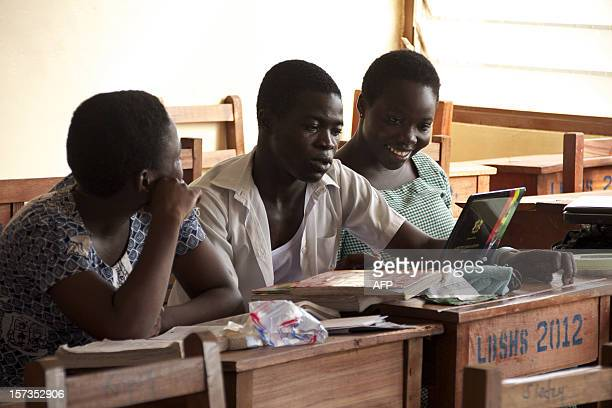 Labone Senior High School students Ernestina Quaye Narteh Andrews and Lisa Okudzetp sit in a classroom on December 1 2012 in Accra Ghana's main...