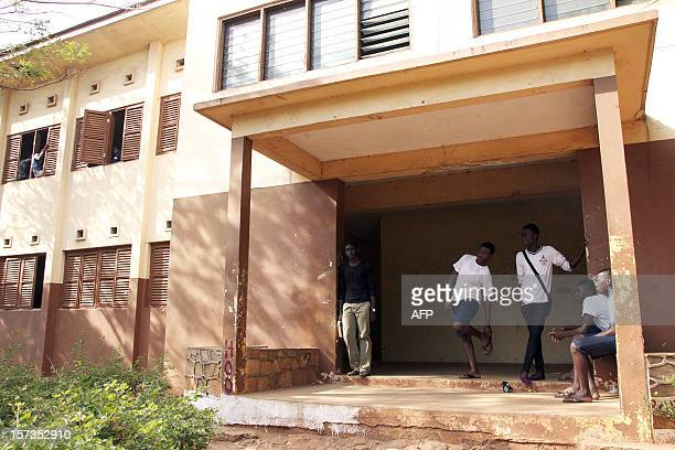 Labone Senior High School students stand outisde a classroom building on December 1 2012 in Accra Ghana's main opposition presidential candidate Nana...