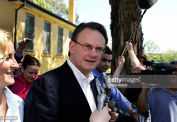 Labor federal opposition leader Mark Latham accompanied by his wife Janine Lacy leaves his Sydney electorate of Werriwa after casting his vote 09...