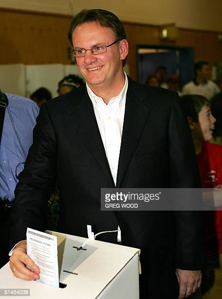 Labor federal opposition leader Mark Latham places his ballot paper in the box in his Sydney electorate of Werriwa 09 October 2004 as Australia's 13...