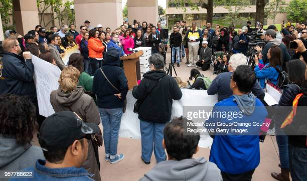 Labor groups with the Anaheim Union Coalition attend a press conference where the group delivered 22000 signatures on petitions to qualify an...