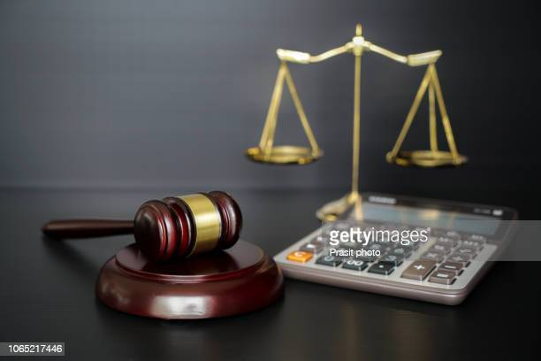 labor law concept, scale, gavel and calculator. - employment law stock photos and pictures