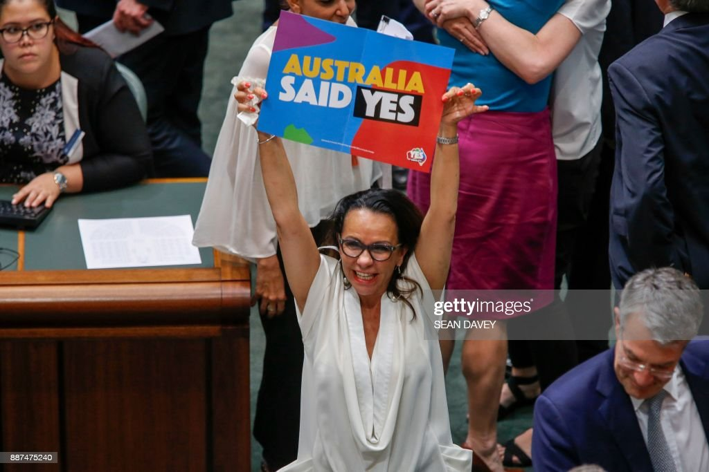 Labor Member of Parliament Linda Burney celebrates as the Australian Parliament passed the same-sex marriage bill in Canberra on December 7, 2017. Gay couples will be able to legally marry in Australia after a same-sex marriage bill sailed through parliament on December 7, ending decades of political wrangling. /