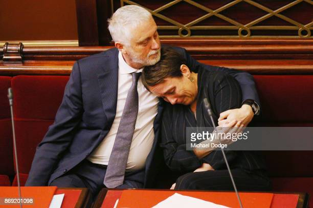 Labor MP Jaala Pulford is hugged by Gavin Jennings MP while crying after speaking about the loss of her daughter on November 2 2017 in Melbourne...