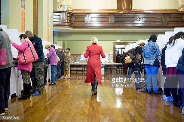 Labor MP Julie Owens walks down the rows of voting booths to cast her vote at the Town Hall on July 2 2016 in Parramatta Australia Voters head to the...