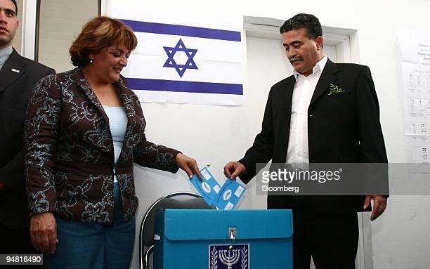 Labor Party leader Amir Peretz, right, and his wife Achlama cast their votes in the Israeli general elections, in the southern Israeli town of...