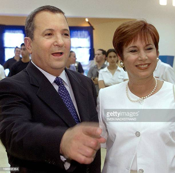 Labor party leader Ehud Barak and his wife Nava talk to the press after casting their vote in Kokhav Yair 17 May 1999 during Israel's general...