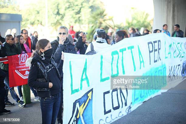 Labor protestors gather nearby as Police patrol before 'The Hunger Games Catching Fire' Premiere during 8th Rome Film Festival at the Auditorium...