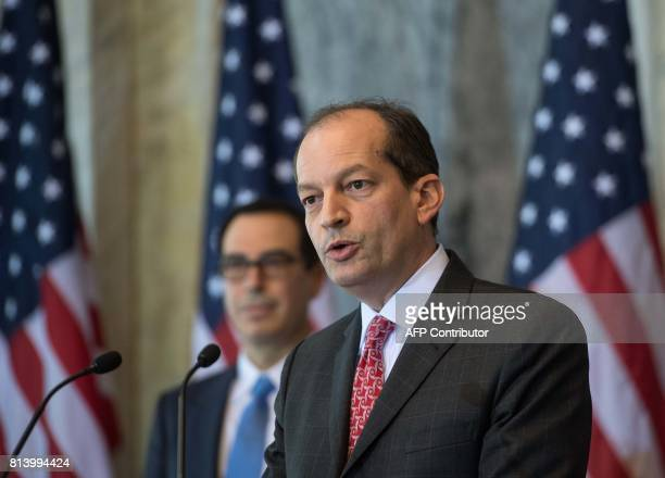 US Labor Secretary Alexander Acosta speaks as Treasury Secretary Steven Mnuchin looks on during a press conference on the Social Security and...