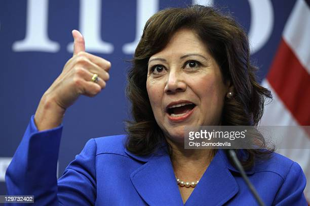 S Labor Secretary Hilda Solis gives a thumbsup during a news conference to announce a partnership between Facebook the National Association of...
