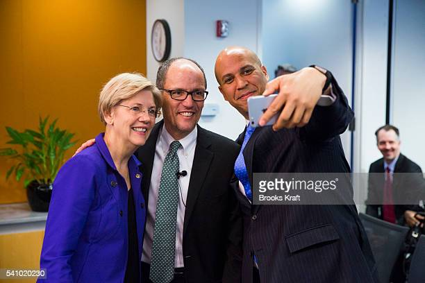 S Labor Secretary Thomas E Perez takes a selfie with Sen Elizabeth Warren and Sen Cory Booker at an event on new fiduciary rule governing personal...