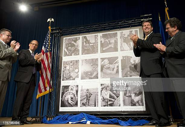 US Labor Secretary Thomas Perez and USPS Postmaster General and CEO Patrick Donahoe applaud after unveiling new postage stamps titled 'Made in...