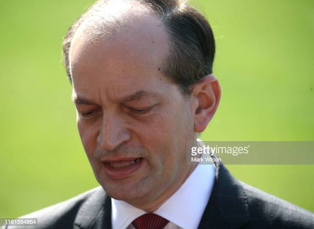 Labor Secretary Alex Acosta stands with US President Donald Trump while announcing his resignation to the media at the White House on July 12 2019 in...