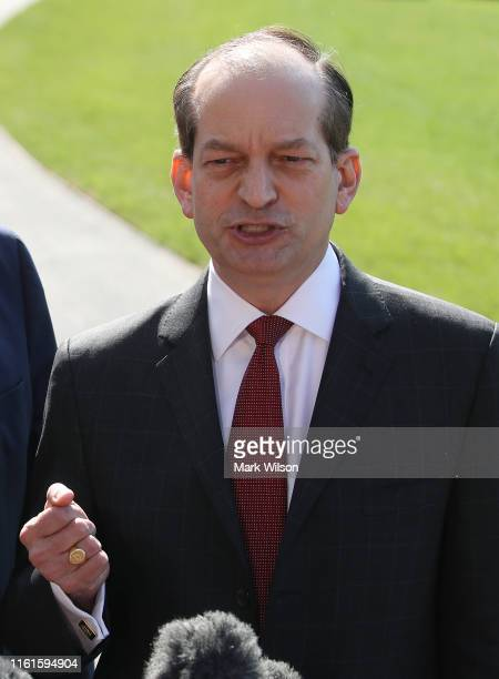 Labor SecretaryAlex Acostastands with US President Donald Trump while announcing his resignation to the media at the White House on July 12 2019 in...