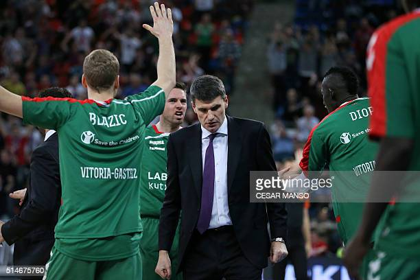 Laboral Kutxa's Croatian coach Velimir Perasovic stands amongst his players during the Euroleague group F Top 16 round 10 basketball match Laboral...