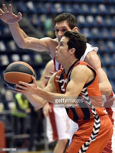 Laboral Kutxa's French guard Thomas Heurtel vies with Red Star Belgrade's center Boban Marjanovic during the Euroleague basketball match between...