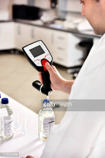 laboratory assistant measuring alcohol degree with alcoholometer - ph value stock pictures, royalty-free photos & images
