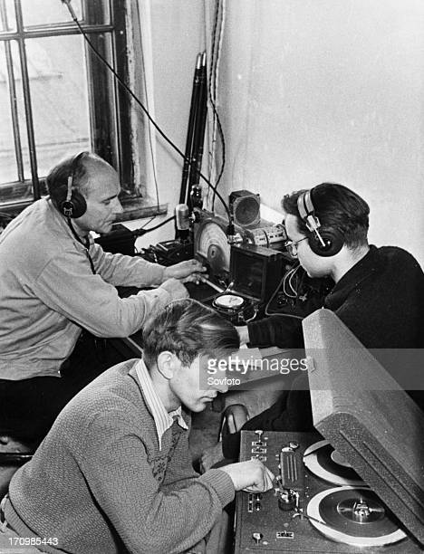 Laboratory assistants at the lvov state university receiving radio signals from sputnik 1 ussr 1957