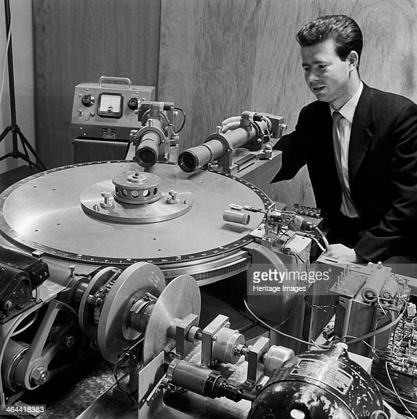 Laboratory at Loughborough University 19601969 A man using electronic scientific equipment and cameras