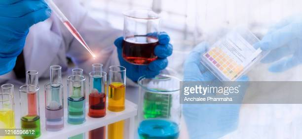 laboratory concept: close up picture of scientist use dropper to transfer chemical reagent to tube research in the laboratory - alkaline stock pictures, royalty-free photos & images