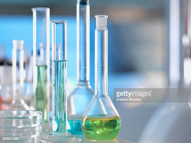 laboratory glassware on lab bench during experiment - beaker stock pictures, royalty-free photos & images