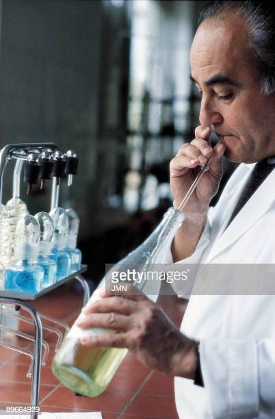 Laboratory of the Institute of Oenologist of Alcazar de San Juan A man makes tests to wine in a bottle in a laboratory of the Institute of Oenologist...