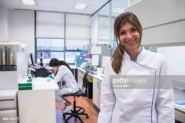 Laboratory technician in analytical laboratory, smiling, portrait