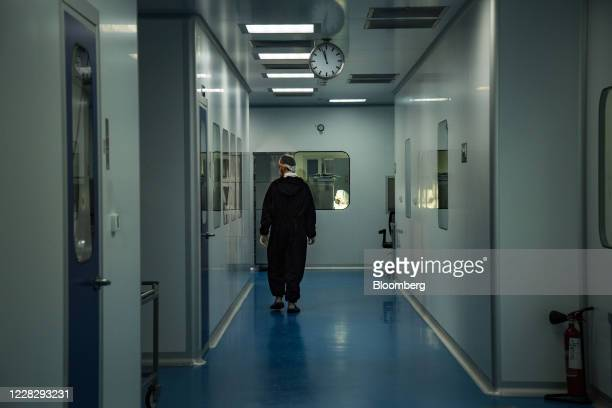 Laboratory technician walks through the Eva Pharma facility used to manufacture the anti-viral drug Remdesivir in Cairo, Egypt, on Aug 2020. One of...