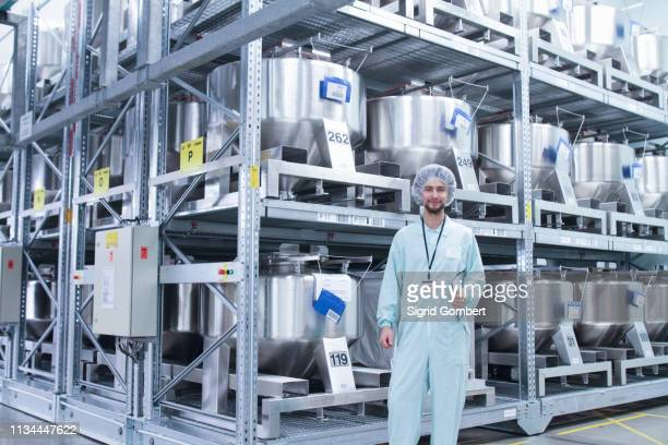 laboratory technician with clipboard - sigrid gombert stock pictures, royalty-free photos & images