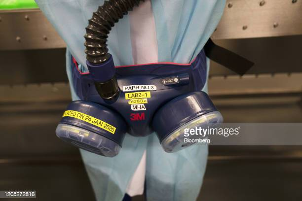 Laboratory technician with the Home Team Science and Technology Agency wears a protective suit and uses a powered, air-purifying respirator,...