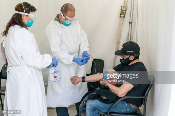 Laboratory technicians take an antibody test for COVID19 at SOMOS Community Care site on resident of Washington Heights SOMOS and Governor Cuomo...