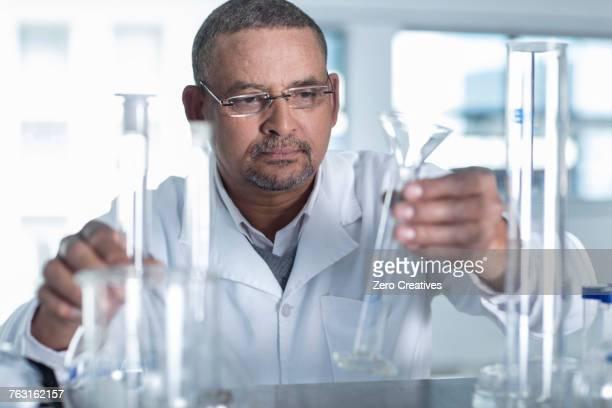 Laboratory worker choosing measuring tube
