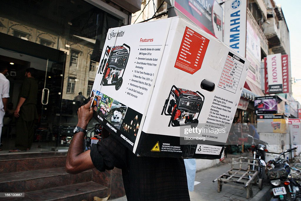 A laborer delivers a Grannitto-branded generator to a generator wholesaler in Karachi, Pakistan, on Monday, May 13, 2013. Nawaz Sharif was headed for a record third term as prime minister of Pakistan as unofficial results from a landmark election gave him the convincing win he sought to tackle a slumping economy and growing militancy. Photographer: Asim Hafeez/Bloomberg via Getty Images