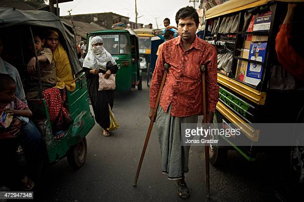 A laborer now has to use crutches after losing his leg in the dangerous working environments on Chittagong beach where they disassemble mega ships...