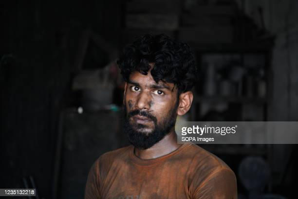 Laborer poses for a photo at a shipyard near the Buriganga River. The shipbuilding industry in Bangladesh is spreading rapidly where workers from all...