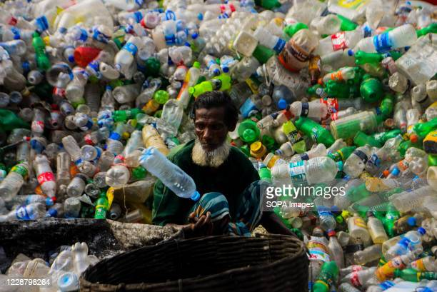 Laborer seen working at a plastic bottle recycling factory in Dhaka.
