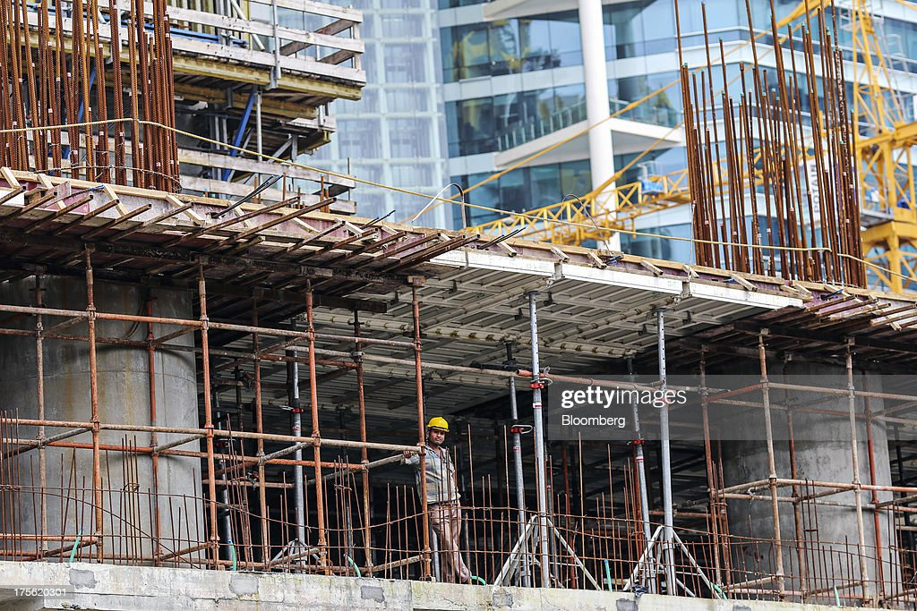 A laborer takes a break at an Indiabulls Real Estate Ltd. commercial building construction site in the Lower Parel area of Mumbai, India, on Sunday, Aug. 4, 2013. Photographer: Dhiraj Singh/Bloomberg via Getty ImagesIndia's purchasing managers index (PMI) for services figures for July are scheduled for release on Aug. 5. Photographer: Dhiraj Singh/Bloomberg via Getty Images