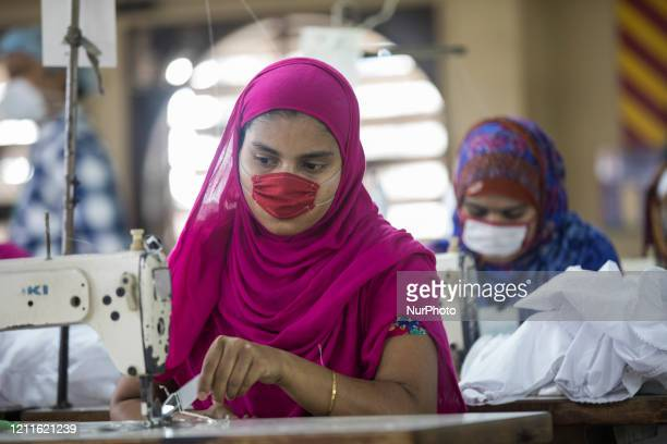 Laborer wearing facemasks working in a garment factory as government has eased restriction on garment factories during coronavirus outbreak in Dhaka...