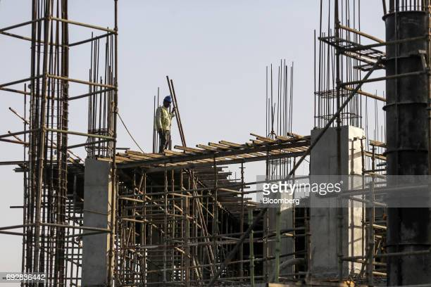 A laborer works at a construction site in Palava City on the outskirts of Mumbai India on Thursday May 25 2017 Lodha Group best known for its luxury...