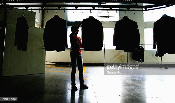 A laborer works at the Youngor Group textile factory on June 8 2005 in Ningbo Zhejiang Province China Peter Mandelson EU trade chief is heading to...