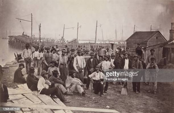 Laborers at Quartermaster's Wharf, Alexandria, Virginia, 1863-65. Formerly attributed to Mathew B. Brady. Artist Attributed to Andrew Joseph Russell.