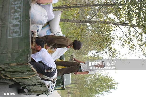 CONTENT] Laborers at the Chongsan Cooperative Farm in North Korea